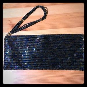 Bebe iridescent beaded wristlet magnetic clutch